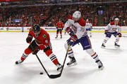 Michal Kempny #6 of the Chicago Blackhawks and Andrei Markov #79 of the Montreal Canadiens battle for the puck at the United Center on November 13, 2016 in Chicago, Illinois. The Blackhawks defeated the Canadiens 3-2.