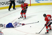 Andrei Markov #79 of the Montreal Canadiens dives to try and stop a pass between Artemi Panarin #72 (top) to Patrick Kane #88 of the Chicago Blackhawks at the United Center on January 17, 2016 in Chicago, Illinois. The Blackhawks defeated the Canadiens 5-2.