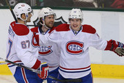 Brendan Gallagher #11 of the Montreal Canadiens celebrates his goal with Max Pacioretty #67 and David Desharnais #51 against the Dallas Stars in the third period at American Airlines Center on January 2, 2014 in Dallas, Texas.