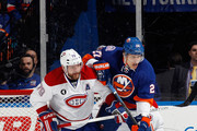 Anders Lee #27 of the New York Islanders is checks in the crease by Andrei Markov #79 of the Montreal Canadiens during the first period at the Nassau Veterans Memorial Coliseum on March 14, 2015 in Uniondale, New York.