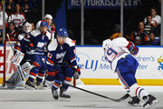 Andrei Markov #79 of the Montreal Canadiens scores a second period goal as Anders Lee #27 of the New York Islanders defends at Nassau Veterans Memorial Coliseum on December 23, 2014 in Uniondale, New York. This was Markov's 800th game.