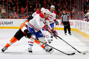 Tomas Plekanec #14 of the Montreal Canadiens tries to keep the puck from Pierre-Edouard Bellemare #78 of the Philadelphia Flyers at the Wells Fargo Center on January 5, 2016 in Philadelphia, Pennsylvania.The Philadelphia Flyers defeated the Montreal Canadiens 4-3.