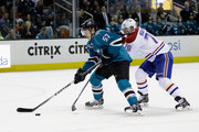 Tommy Wingels #57 of the San Jose Sharks skates past Andrei Markov #79 of the Montreal Canadiens at SAP Center on March 2, 2015 in San Jose, California.