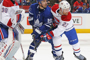 Tomas Plekanec #19 of the Toronto Maple Leafs battles between Charlie Lindgren #39 and Karl Alzner #22 of the Montreal Canadiens during an NHL game at the Air Canada Centre on March 17, 2018 in Toronto, Ontario, Canada. The Maple Leafs defeated the Canadiens 4-0.