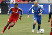 Reggie Lambe  #19 of Toronto FC chases down Marco Di Vaio #9 of the Montreal Impact during MLS action at BMO Field October 20, 2012 in Toronto, Ontario, Canada.