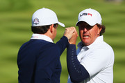 Phil Mickelson (R) of the United States celebrates with Keegan Bradley on the 16th green during the Morning Fourballs of the 2014 Ryder Cup on the PGA Centenary course at the Gleneagles Hotel on September 26, 2014 in Auchterarder, Scotland.