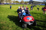 Phil Mickelson and wife Amy Mickelson celebrate victory as they are driven off the 18th hole in a golf buggy during the Morning Fourballs of the 2014 Ryder Cup on the PGA Centenary course at the Gleneagles Hotel on September 26, 2014 in Auchterarder, Scotland.