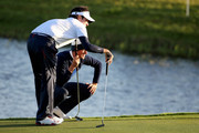 Webb Simpson and Bubba Watson of the United States line up a putt on the 2nd green during the Morning Fourballs of the 2014 Ryder Cup on the PGA Centenary course at the Gleneagles Hotel on September 26, 2014 in Auchterarder, Scotland.
