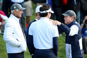 United States team captain Tom Watson (R) and Vice-Captain Andy North (L) talk to Bubba Watson and Webb Simpson of the United States after their defeat during the Morning Fourballs of the 2014 Ryder Cup on the PGA Centenary course at the Gleneagles Hotel on September 26, 2014 in Auchterarder, Scotland.