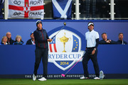 Webb Simpson (L) of the United States hits the opening tee shot with Bubba Watson during the Morning Fourballs of the 2014 Ryder Cup on the PGA Centenary course at the Gleneagles Hotel on September 26, 2014 in Auchterarder, Scotland.