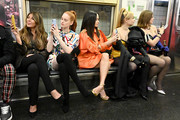 (L-R) Nina Garcia, Madelaine Petsch, Kacey Musgraves, Kim Petras and Julia Fox attend the Moschino Prefall 2020 Runway Show front row at New York Transit Museum on December 09, 2019 in Brooklyn City.