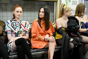 (L-R) Madelaine Petsch, Kacey Musgraves, and Kim Petras attend the Moschino Prefall 2020 Runway Show front row at New York Transit Museum on December 09, 2019 in Brooklyn City.