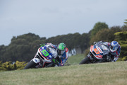 Anthony West of Australia and AB Motoracing leads  Mike Di Meglio of France and Avintia Racing  during free practice for the 2015 MotoGP of Australia at Phillip Island Grand Prix Circuit on October 16, 2015 in Phillip Island, Australia.
