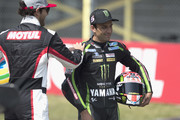 """Johann Zarco of France and Monster Yamaha Tech 3 and Bruno Senna . of Brasile (L) joke during the pre-event """"A race between a Yamaha M1 and a McLaren GT3"""" during the MotoGP Netherlands - Preview on June 22, 2017 in Assen, Netherlands."""