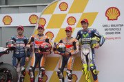 (L-R) Hector Barbera of Spain and Avintia Racing, Marc Marquez of Spain and Repsol Honda Team, Dani Pedrosa of Spain and Repsol Honda Team and Valentino Rossi of Italy and Movistar Yamaha MotoGP pose at the end of the qualifying practice during the MotoGP Of Malaysia at Sepang Circuit on October 24, 2015 in Kuala Lumpur, Malaysia.