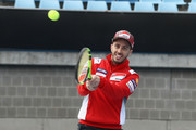 Andrea Dovizioso of Italy and Ducati Team plays tennis during a media call ahead of the 2018 MotoGP of Australia at Melbourne Park on October 24, 2018 in Melbourne, Australia.