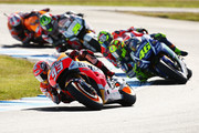 Marc Marquez of Spain and the Repsol Honda Team leads Valentino Rossi of Italy and Movistar Yamaha MotoGP and competitors during the 2015 MotoGP of Australia at Phillip Island Grand Prix Circuit on October 18, 2015 in Phillip Island, Australia.
