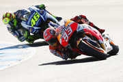 Marc Marquez of Spain and the Repsol Honda Team leads Valentino Rossi of Italy and Movistar Yamaha MotoGP during the 2015 MotoGP of Australia at Phillip Island Grand Prix Circuit on October 18, 2015 in Phillip Island, Australia.