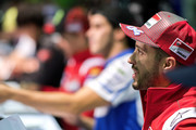 Andrea Dovizioso of Italy and Ducati Team signs autographs for fans during the autographs session during the MotoGP of Japan - Free Practice at Twin Ring Motegi on October 19, 2018 in Motegi, Japan.