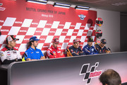 (L-R) Alex Rins of Spain and Team Suzuki ECSTAR, Andrea Dovizioso of Italy and Ducati Team, Marc Marquez of Spain and Repsol Honda Team, Maverick Vinales of Spain and  Movistar Yamaha MotoGP and  Dani Pedrosa of Spain and Repsol Honda Team  pose during the press conference pre-event during the MotoGP of Japan - Previews at Twin Ring Motegi on October 18, 2018 in Motegi, Japan.
