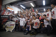 Marc Marquez of Spain and Repsol Honda Team celebrates the MotoGP victory and becoming the 2018 MotoGP champion at the end of the MotoGP race with team in box during the MotoGP of Japan - Race at Twin Ring Motegi on October 21, 2018 in Motegi, Japan.