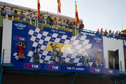 L-R Nico Terol of Spain and Bancaja Aspar Team, Marc Marquez of Spain and Red Bull AJo Motorsport and Pol Espargaro of Spain and Tuenti Racing celebrate and spray champagne on the podium  at the end of the 125 cc race of Grand Prix of Netherlands in TT Assen Circuit on June 26, 2010 in Assen, Netherlands.