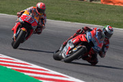 Jorge Lorenzo of Spain and Ducati Team leads Marc Marquez of Spain and Repsol Honda Team during the MotoGP race during the MotoGP of San Marino - Race at Misano World Circuit on September 9, 2018 in Misano Adriatico, Italy.