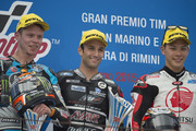 (L-R) Esteve Rabat of Spain and Estrella Galicia 0,0 Marc VDS, Johann Zarco of French and AJO Motorsport  and Takaaki Nakagami of Japan and Idemitsu Honda Team Asia celebrate on the podium after the Moto2 World Championship race during the San Marino GP at Misano World Circuit on September 13, 2015 in Misano Adriatico, Italy.