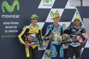(L-R) Alex Rins of Spain and Pagina Amarillas HP40, Esteve Rabat of Spain and Estrella Galicia 0,0 Marc VDS and Johann Zarco of French and AJO Motorsport  celebrate at the end of the qualifying practice during the MotoGP of Spain - Qualifying at Motorland Aragon Circuit on September 26, 2015 in Alcaniz, Spain.