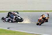 Pol Espargaro of Spain and Pons 40 HP Tuenti after crashing with Marc Marquez of Spain and Team CatalunyaCaixa Repsol during the Moto2 race at Circuit de Catalunya on June 3, 2012 in Montmelo, Spain. Iannone was first, Luthi second and Marquez third.
