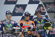 (L-R) Jorge Lorenzo of Spain and Movistar Yamaha MotoGP, Marc Marquez of Spain and Repsol Honda Team and Valentino Rossi of Italy and Movistar Yamaha MotoGP pose and celebrate at the end of the qualifying practice during the MotoGp Red Bull U.S. Grand Prix of The Americas - Qualifying at Circuit of The Americas on April 9, 2016 in Austin, Texas.
