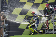 Valentino Rossi of Italy and Jorge Lorenzo of Spain (L) and Movistar Yamaha MotoGP celebrate with champagne on the podium at th end of the MotoGP race during the MotoGp of Catalunya at Circuit de Catalunya on June 14, 2015 in Montmelo, Spain.