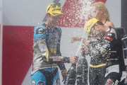 Esteve Rabat of Spain and Estrella Galicia 0,0 Marc VDS and Johann Zarco of French and AJO Motorsport  (R) celebrate on the podium at the end of the Moto2 race during the MotoGp of Czech Republic - Race at Brno Circuit on August 16, 2015 in Brno, Czech Republic.