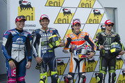 (L-R) Aleix Espargaro of Spain and Power Electronics Aspar, Valentino Rossi of Italy and Yamaha Factory Racing, Marc Marquez of Spain and Repsol Honda Team and Cal Crutchlow of Great Britain and Monster Yamaha Tech 3 pose at the end of the MotoGp of Germany - Qualifying at Sachsenring Circuit on July 13, 2013 in Hohenstein-Ernstthal, Germany.