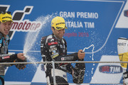 Esteve Rabat of Spain and Estrella Galicia 0,0 Marc VDS and  Johann Zarco of French and AJO Motorsport (R) celebrate on the podium at the end of the Moto2 race during the MotoGp of Italy - Race. at Mugello Circuit on May 31, 2015 in Scarperia, Italy.