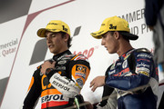 Marc Marquez of Spain and Team Catalunya Caixa Repsol and Pol Espargaro of Spain and Pons 40 HP Tuenti (R) celebrate on the podium at the end of the Moto2 race of MotoGP of Qatar at Losail Circuit on April 8, 2012 in Doha, Qatar.