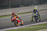 Marc Marquez of Spain and Repsol Honda Team leads Valentino Rossi of Italy and Movistar Yamaha MotoGP during the MotoGP race during the MotoGp of Qatar - Race at Losail Circuit on March 20, 2016 in Doha, Qatar.