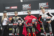 (L-R)  Jonathan Rea of Great Britain and KAWASAKI RACING TEAM WorldSBK, Tom Sykes of Great Britain and KAWASAKI RACING TEAM WorldSBK and Loris Baz of France and Gulf Althea BMW Racing Team celebrate at the end of the Super Pole during the Motul FIM Superbike World Championship - Race One at Donington Park on May 26, 2018 in Castle Donington, England.