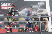(L-R) Jonathan Rea of Great Britain and KAWASAKI RACING TEAM WorldSBK,  Michael Van Der Mark of Netherlands and PATA Yamaha Official WorldSBK Team and Tom Sykes of Great Britain and KAWASAKI RACING TEAM WorldSBK celebrate on the podium at the end of the Superbike Race 1 during the Motul FIM Superbike World Championship - Race One at Donington Park on May 26, 2018 in Castle Donington, England.