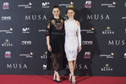 Spanish actresses Leonor Watling (L) and  Manuela Velles (R) attend the 'Musa' premiere at the Callao cinema on November 6, 2017 in Madrid, Spain.