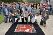 (L-R) Austin Scaggs, Matthew Followill, Jared Followill, Karl Dean, Nathan Followill and Caleb Followill attend Music City Walk Of Fame Induction Ceremony Honoring Kings Of Leon at Walk of Fame Park on September 21, 2012 in Nashville, Tennessee.