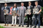 (L-R) Caleb Followill, and Nathan Followill, of the band Kings of Leon pose with Nashville Mayor Karl Dean, center with Jared Followill, and Matthew Followill of Kings of Leon with their Music City Ambassador awards at the Music City Walk Of Fame Induction Ceremony Honoring Kings Of Leon at Walk of Fame Park on September 21, 2012 in Nashville, Tennessee.