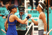 Caroline Garcia of France is congratulated on victory by opponent Sorana Cirstea of Romania during day four of the Mutua Madrid Open at La Caja Magica on May 07, 2019 in Madrid, Spain.