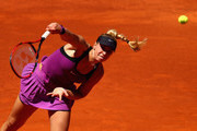 Sabine Lisicki of Germany serves against Carla Suarez Navarro of Spain in their second round match during day four of the Mutua Madrid Open tennis tournament at the Caja Magica on May 03, 2016 in Madrid,Spain.
