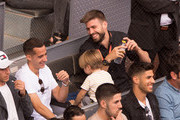 Gerard Pique (right) of FC Barcelona has a laugh with Lucas Vazquez of Real Madrid while attending the quarterfinal match between Rafael Nadal of Spain and Dominic Bertens of the Netherlands on day seven of Mutua Madrid Open at the Caja Magica on May 11, 2018 in Madrid, Spain.