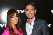 Harry Kewell (R) and his wife Sheree Murphy arrive at the Myer Autumn Winter 2014 Fashion Launch at Myer Mural Hall on February 20, 2014 in Melbourne, Australia.