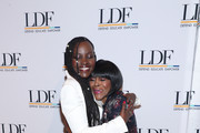 Lupita Nyong'o and Cicely Tyson embrace at the NAACP LDF 33rd National Equal Justice Awards Dinner at Cipriani 42nd Street on November 07, 2019 in New York City.