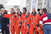 Space Shuttle Atlantis Commander Ken Ham (R-L), Pilot Tony Antonelli, Mission Specialists Garrett Reisman, Michael Good, Steve Bowen and Piers Sellers walk out of NASA's operations and checkout building and into the astronaut van at Kennedy Space Center May 14, 2010 in Cape Canaveral in preparation for their launch later today. This is scheduled to be the final launch for Atlantis.