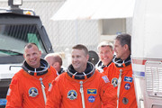 Space Shuttle Atlantis Commander Ken Ham (R), and Pilot Tony Antonelli (L), lead the rest of the crew out of NASA's operations and checkout building and into the astronaut van at Kennedy Space Center May 14, 2010 in Cape Canaveral in preparation for their launch later today. This is scheduled to be the final launch for Atlantis.