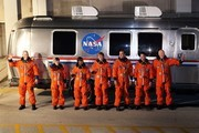 NASA's STS-131 astronauts (R-L), Commander Alan Poindexter, Pilot James P. Dutton Jr., mission specialists Rick Mastracchio, Dorothy Metcalf-Lindenburger, Stephanie Wilson, Japan Aerospace Exploration Agency astronaut Naoko Yamazaki and NASA astronaut Clayton Anderson walk out of the operations and checkout building at Kennedy Space Center April 5, 2010, in Cape Canaveral, Florida. The shuttle crew is scheduled for a 13 day trip to the International Space Station.